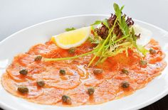This is a recipe for salmon carpaccio. The salmon fillet is served raw like a sushimi or a tartare. It's delicious and refreshing and a perfect appetizer.