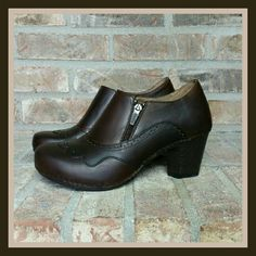 """Dansko Nancy Pull Up Bootie Clog This women's clog offers a leather upper accented by a scalloped overlay w/ brogue-inspired perforations, rivets & stitching details, as well as a half-zip closure & elastic goring for on/off ease & all-day comfort. The leather-covered footbed & midsole offer layers of cushy EVA support for lasting comfort, plus a little extra padding at the arch with an approx 2.75"""" heel. They are in good shape with some minimal scuffing on the toes and general wear. SORRY…"""
