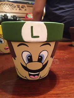 Luigi painted flower pot to hold luigi lemon drops candy