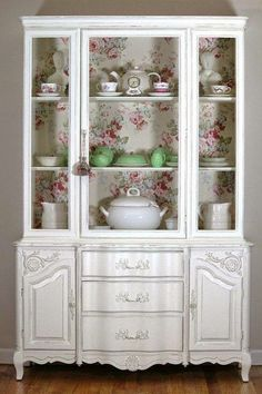 Charming renovated china cabinet. The floral back is what makes this piece to me; I'm not a fan of stark white.