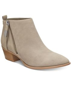 A refined silhouette with zipper details and block heel bring contemporary chic to jeans and skirts alike in Circus by Sam Edelman's Heidi booties. | Nubuck leather or suede uppers; manmade sole | Imp
