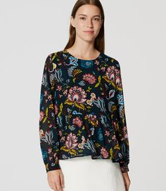 Floral Peplum Blouse size Large. I love the print and the colors.
