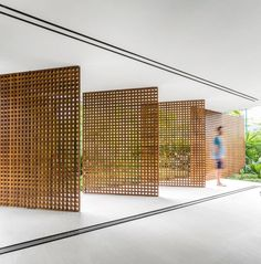 Love how the wood/mesh walls open up. That could be a great divider for an indoor/outdoor area or an outdoor shower area