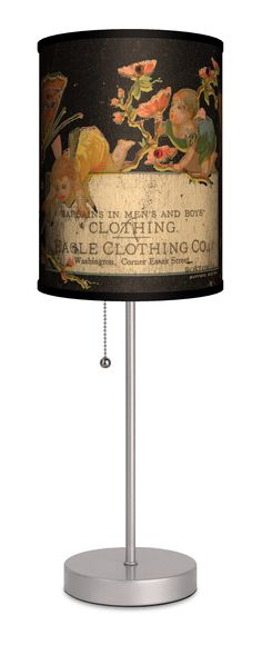 """Vintage Labels Eagle Clothing Co. 20"""" H Table Lamp with Drum Shade"""