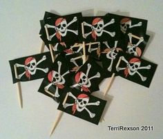 little pirate flags made out of tooth picks. Maybe I'll make to go on the cake or on cup cakes!