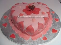 Homemade Vaelntines Cake: I decided to make all the Mum's at my children's playgroup a Valentines cake just as a treat. I used a heart shaped cake tin and baked a vanilla sponge