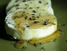 Honey Marinated Goat Cheese with Lavender. Marinate with honey in the refrigerator for an hour or two. 4 ounces goat cheese, sliced into 4 rounds (if puck-shaped) or 6 rounds (if log-shaped)1 tablespoon honey 1/2 teaspoon dried culinary lavender, finely chopped.Sea salt.Put the goat cheese on a serving platter. Drizzle with honey, sprinkle with lavender.Serve with fruit, nuts, & slices of a great baguette.