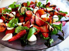 strawberry salad salad with mozzarella,strawberry,cherry tomato, rocket and basil with a balsamic vinegar dressing