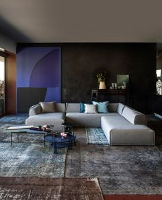 Patricia Urquiola residential projects. living room decor ideas. blue and light colors. white sofa. best projects. best interior designers. For more inspirations visit us at www.bocadolobo.com