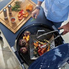 This signature Weber™ steel kettle design in blue porcelain-enameled finish is a Crate and Barrel exclusive. Be sure to add it to your registry! [Promotional Pin]