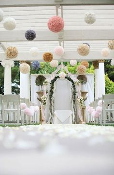 poms are a pretty way to add your wedding colors and can be hung from trees, ceilings, chairs...