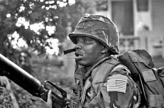 A US Marine armed with M16A1 rifle patrols the area around Grenville during the Invasion of Grenada, codenamed Operation Urgent Fury October 25, 1983