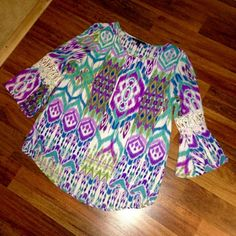 Zac & Rachel Aztec Print Bell Sleeve Blouse NWOT Zac & Rachel Aztec Print Bell Sleeve Blouse. Has gorgeous crochet detail on sleeves (see pics). 100% polyester. Hi-lo hem and flowy fit. Perfect for spring and summer! True to size! Open to offers! Zac & Rachel Tops Blouses