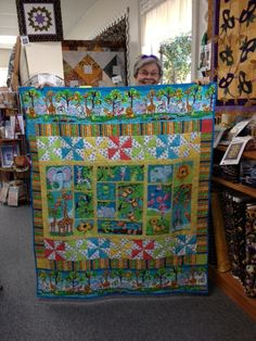 Alligator tales.  This is a great quilt for this fabric line.  By Mary at Bright Hopes Quilt Shop.  If I made it I might take out the pinwheels.