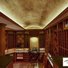 traditional wine cellar by Charles River Wine Cellars with library ladder