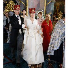 It was time for a royal wedding in Belgrade as Prince Philip of Serbia tied the knot with his love Danica Marinkovic at the Cathedral Church of St. Michael the Archangel on October 7. Danica was the picture of happiness in a full-length silk princess gown that featured billowy sheer long sleeves, an oversized bow sash at the waist and a sweeping train. Photo by Milica Radicevic/WireImage