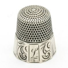 "beautiful old thimbles, esp. ornate sterling.......it even has an ""L"" for her name..... oh!!!"