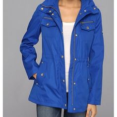 """Michael Kors anorak jacket Bright blue anorak jacket accented with gold hardware, hidden drawstring waist and has an optional hood. 100% polyester. Measurements: 27"""" length, 15.5"""" across the chest and 21.5"""" (hemmed) sleeves. Authentic. Great condition. Michael Kors Jackets & Coats"""