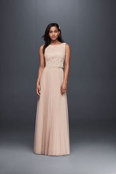 For a dose of soft color, try Donna Morgan's two-piece wedding dress with a sleeveless lace top and softly pleated mesh skirt. Available at David's Bridal.