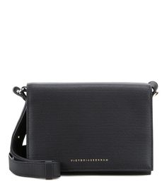 Victoria Beckham - Mini embossed leather shoulder bag -  This sleek and compact design is simple and timeless, and the textured, embossed black leather adds endless versatility. Adjust the shoulder strap and wear yours cross-body when you need to go hands-free. - @ www.mytheresa.com