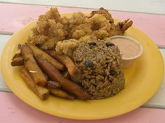 Conch Combo:  Conch Fritter, Cracked Conch, Peas & Rice and home makde fries at the Conch Shake on Turks and Caicos