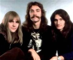 RUSH. - Neil Peart,Alex Lifeson, and Geddy Lee..............