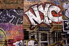 Graffiti sign in lower Manhattan Wall Mural