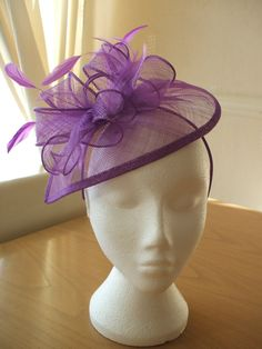 Purple fascinator with feathers