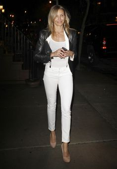 Cameron Diaz..... White skinnies with suspenders, nude heels, and leather jacket.