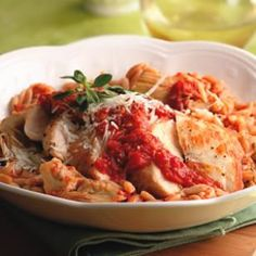 Healthy food. Chicken and sun-dried tomato orzo.
