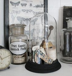 Great Decor and DIY stuff on this blog! I love this use of the old glass clock dome.