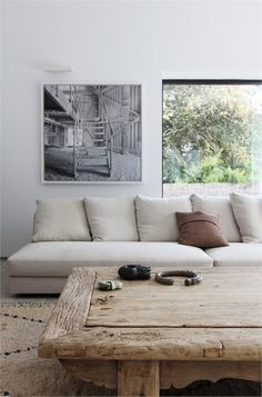 This wooden table and light accents give the impression of a more earthy and woodsy sophistication. #apartment #design