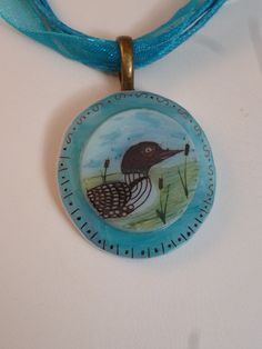 Small loon and cattails Pendant writh by SuperiorPendantsPlus