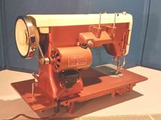 At the time (post WWII) the White Sewing Machine Co. was supplying sewing machines to Kenmore, and they contracted with Pfaff in Germany to produce these burly, precision machines.