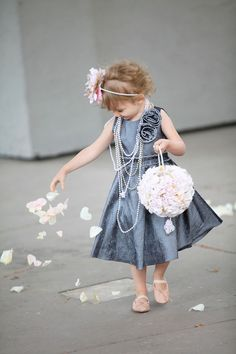 Aww, cute flower girl in gray dress with pearls, flower headband and flower ball bouquet!