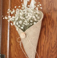 Khaki burlap pew cone with reclaimed wood button / rustic wedding decoration. Handmade by Nutfield Weaver.
