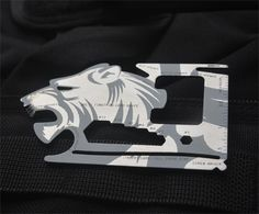 Wild Tribe Tiger shape 18 in 1 Multifunction Tool EDC Pocket Card Outdoor Camping Wallet Survival Stainless steel Knife. Multi Function Credit Card Sized Flat Tool FITS PERFECTLY in Your Pocket, Pouch or Wallet and its Multi Use Tools CAN SERVE YOU at Work, Home, Office, College, Job, Party, Bar, Car, Nature, Camping, Fishing. Small & Lightweight Wallet Tool for Survival & Camping.Handy Multitool Card to Unscrew, Cut, Peel, Bend, Measure, Open Cans, Letters, Boxes, Bottles, Fruits and…
