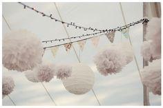 fun hanging poms and lanterns