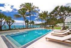 Fairshore 38 Noosa Heads Lined with palm trees, Noosa Main Beach is located opposite Fairshore 38, ideal for those who enjoy a swim in the ocean. This beachfront property also offers access to an outdoor swimming pool.