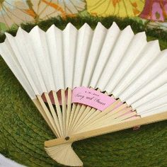 White Paper Fans (Event Blossom EB1015) | Buy at Wedding Favors Unlimited (http://www.weddingfavorsunlimited.com/white_paper_fans.html).