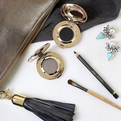 What's your purse personality? This season, it's all in the details. Stay #ontrend and opt for handbags with tassels, pom poms, and daring patterns. Finish your look by matching your #makeup to an accent color that's on your bag.