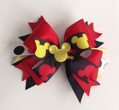 Made with -Yellow Mickey Mouse head - Red & Yellow Mickey Mouse ribbon - Polka dotted ribbon - Red & Black ribbons - reaches about 5 inches