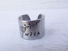 'Wish hand stamped silver aluminum cuff ring' is going up for auction at  4pm Tue, Jul 31 with a starting bid of $6.