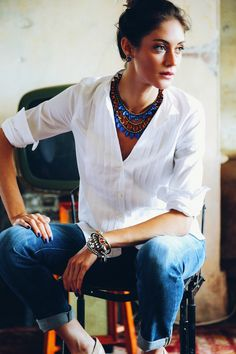 white shirt and bold accessories