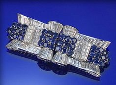 SAPPHIRE AND DIAMOND DOUBLE-CLIP/BROOCH, 1930S
