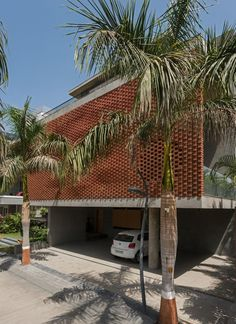 Rippling red brick facade shades house in Surat by Design Work Group Home Building Design, Building Facade, Cost Of Bricks, Dream Home Design, House Design, Brick Face, Brick Architecture, Interior Architecture, Residential Architecture