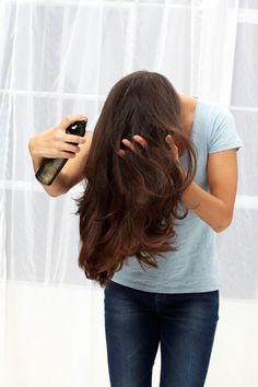 Step 4: Flip your head over and mist hair's underside with a texturizing spray. Use your fingers to massage the roots, then flip back up and finger-comb into place.