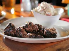 Get Stout-Marinated Steak Tips Recipe from Food Network Steak Tips, Beef Tips, Steak Recipes, Grilling Recipes, Cooking Recipes, Porterhouse Steak Recipe, Marinated Steak, Grilled Beef, Bbq Steak