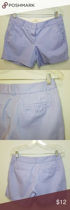 """J. Crew Broken-In 5"""" Chino Shorts Lavender J. Crew broken-in chino shorts. 5"""" inseam. Excellent condition. I purchases these new and wore them once. Size 4. 15"""" waist, 9"""" rise, 3 1/4"""" zipper, 5"""" inseam, 20"""" hips. 100% cotton. Small factory flaw on right rear - an approx 2"""" yellow thread streak. J. Crew Factory Shorts"""