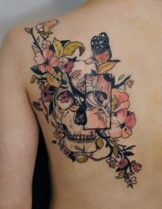 Skull Tattoo. A very creative combination of life and death. The branch is beautifully done, and I especially think that the magnified rectangle is a great artistic addition to the tattoo.